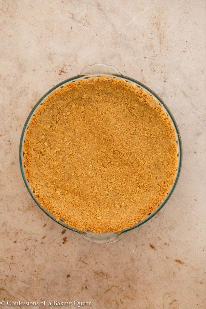 par baked graham cracker pie crust on a light brown surface
