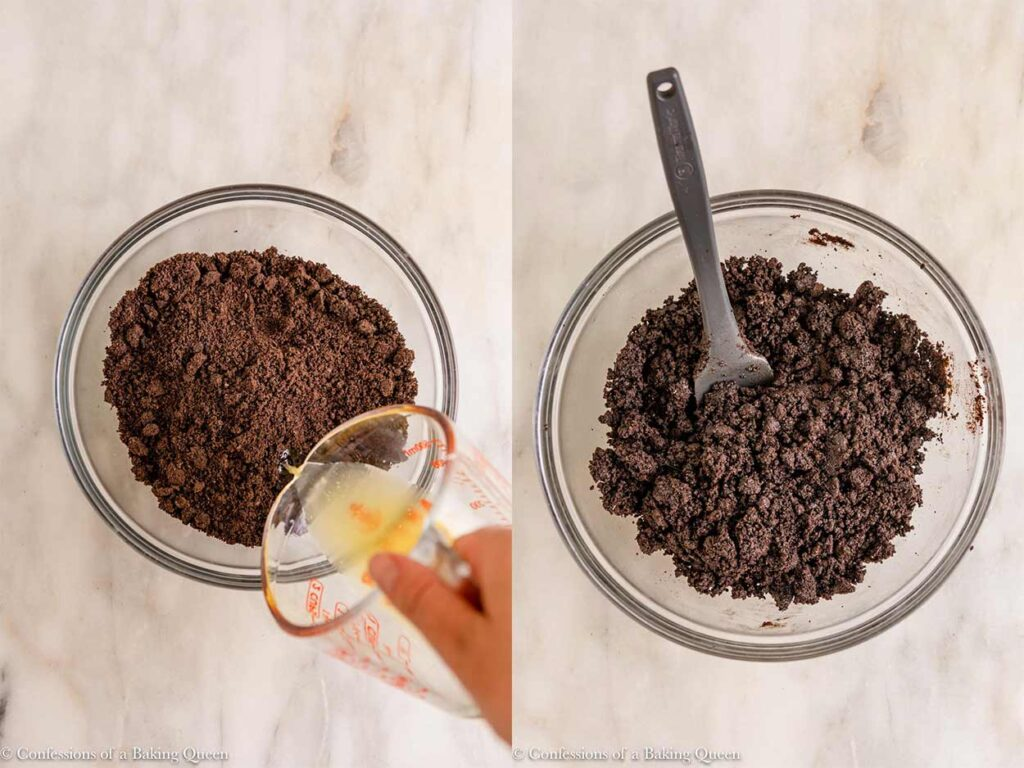 melted butter mixed into oreo crumbs to make an oreo crust in a glass bowl on a marble surfac