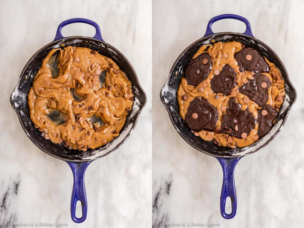 chocolate chip cookie batter in a skillet with holes for brownie batter to add on top on a white marble surface