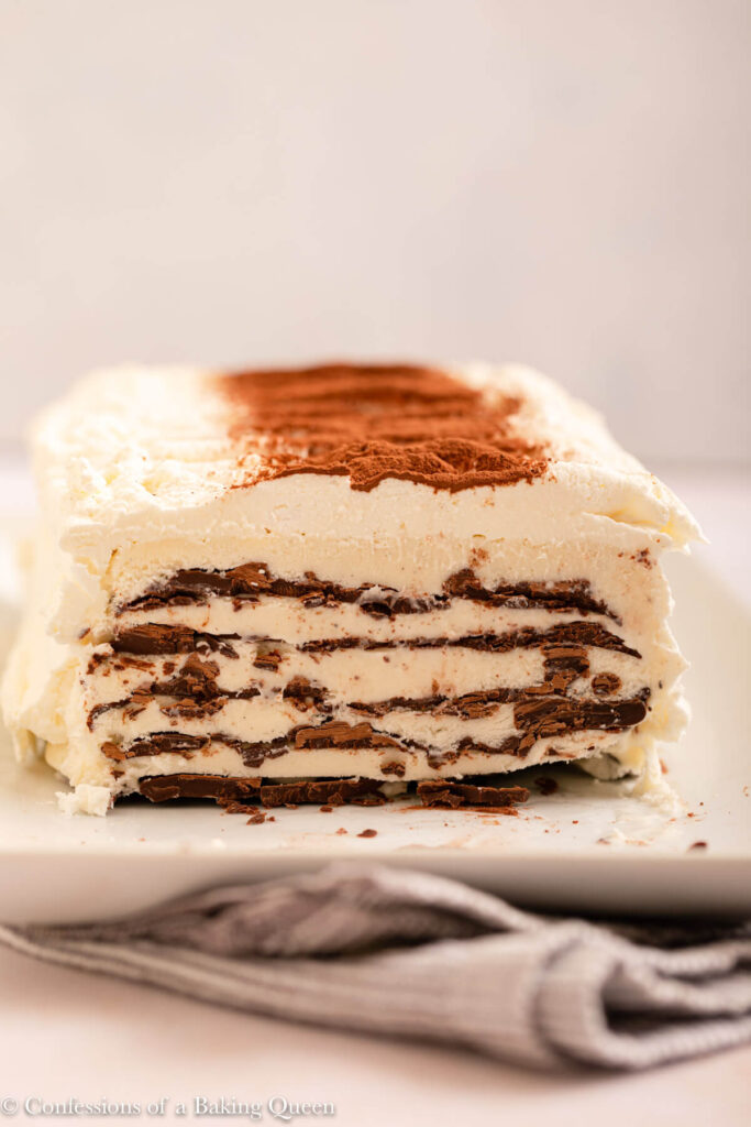 cut open homemade viennetta ice cream cake on a white plate on a light cream surface
