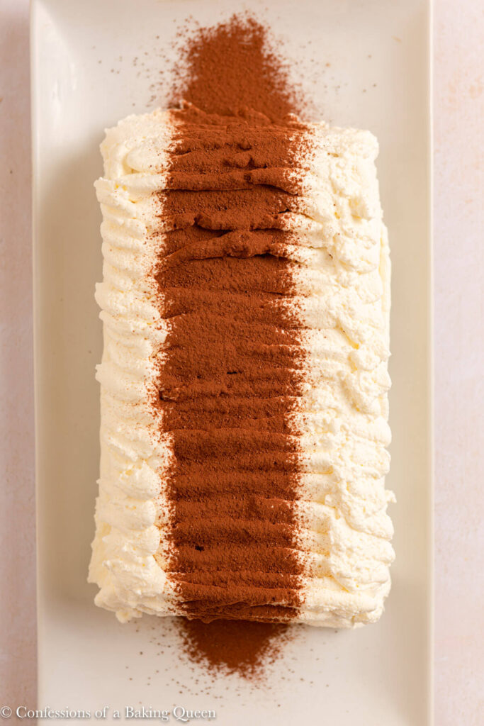 homemade viennetta ice cream cake served on a white plate on a light cream surface