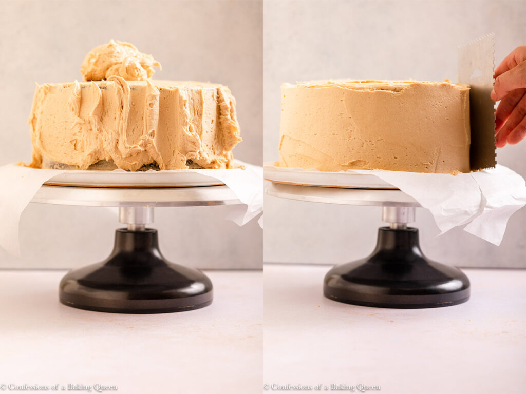 peanut butter frosting spread on to chocolate cake layers on a cake turntable on a light cream surface